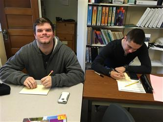 2 students taking a test