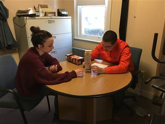 2 students sitting at a table
